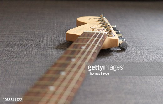 A Close Up Photograph Of A Sunburst Finish Solid Body Electric