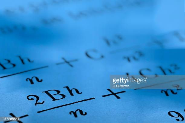 Close up photograph of mathematics on paper with blue tint