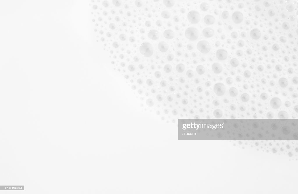 Close up photograph of milk with bubbles