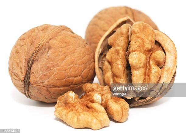 Close up photograph of three walnuts, one cracked open