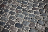 Close up picture of old cobblestone street, background or texture.