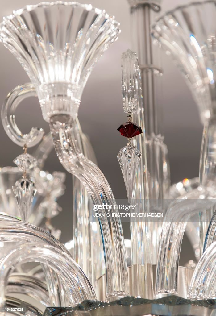 A close up picture taken on October 16, 2012 shows a chandelier displayed in a shop of French crystal glass maker Baccarat in Nancy, eastern France.