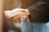 close up  politeness of businesswoman handshake with partner vendor,collaboration of ceo leader hand shake for agreement or deal financial cooperative concept.