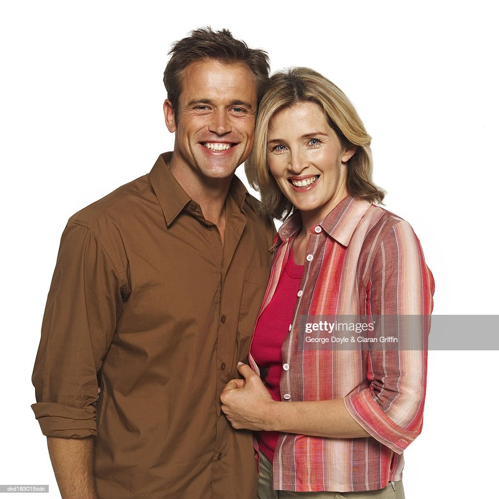 Close up portrait of a husband and wife embracing : Stock Photo