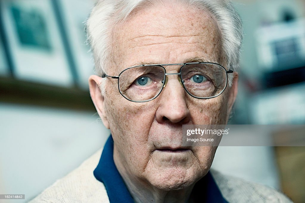 Close up portrait of a senior man looking confused