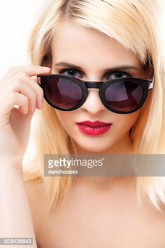 Close up portrait of a woman with sun glasses