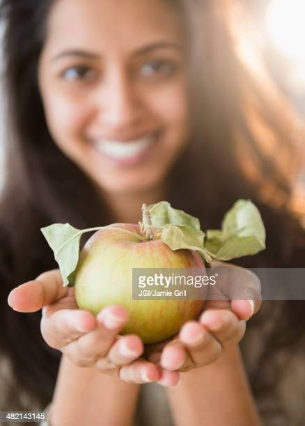 Close up portrait of Asian woman holding fresh apple