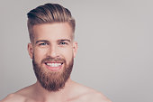 Close up portrait of cheerful handsome attractive excited satisfied emotional brutal kind friendly attractive stunning macho with stylish modern haircut isolated on gray background copy-space