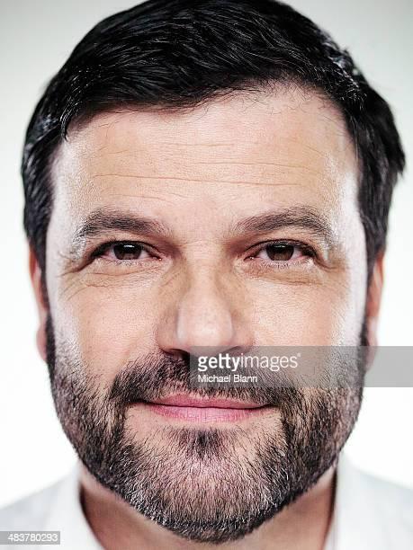 Close up portrait of confident man