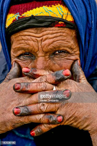 Close up portrait of elderly nomadic Berber woman in traditional dress with hands tattoo in Moroccan henna on September 15 2005 in the Moroccan Atlas...