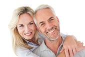 Close up portrait of happy mature couple over white background