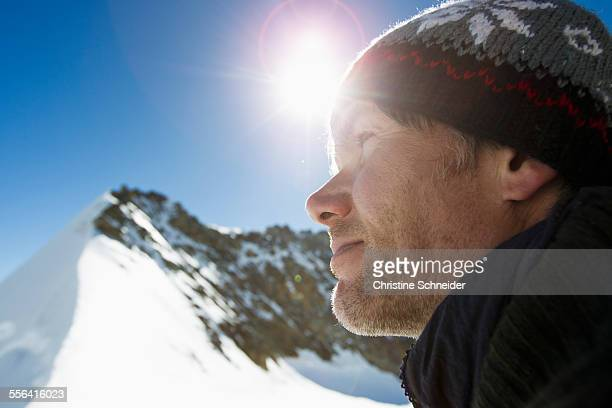 Close up portrait of hiker in snow covered mountains, Jungfrauchjoch, Grindelwald, Switzerland