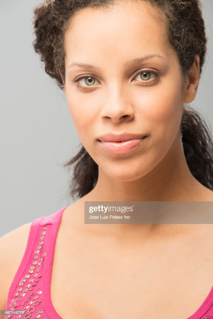Close up portrait of mixed race woman : Stock Photo