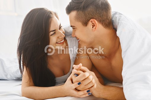 Close up portrait of romantic couple in bed   Stock Photo. Close Up Portrait Of Romantic Couple In Bed Stock Photo   Thinkstock