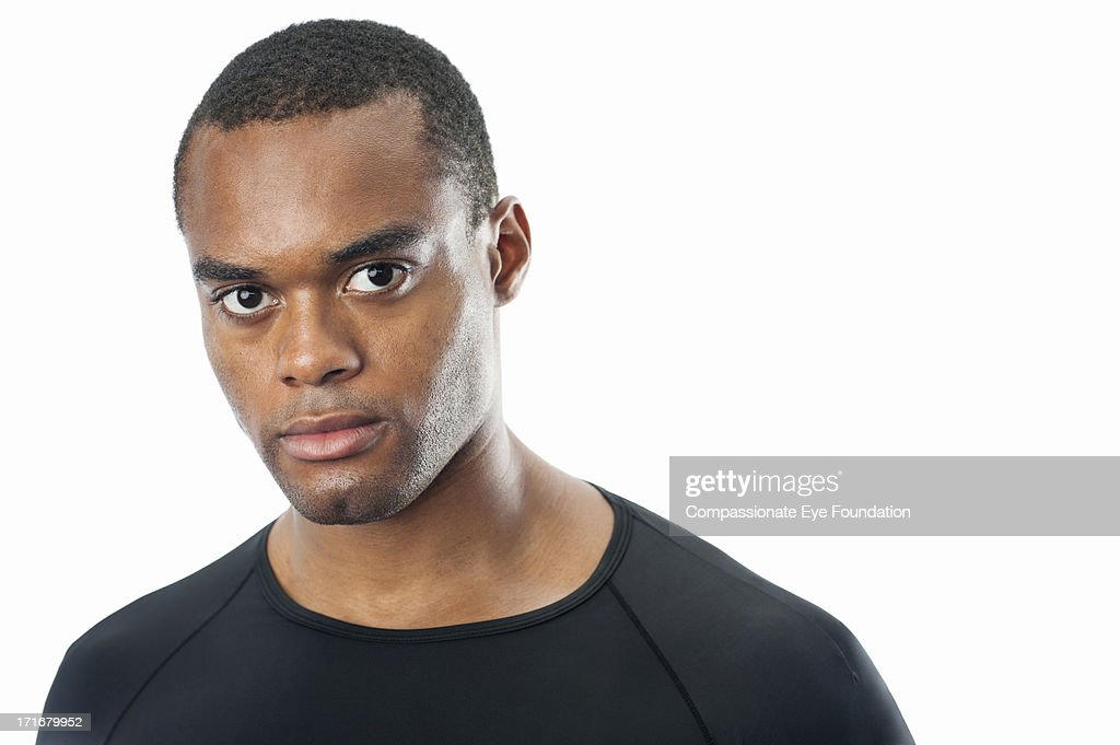 Close up portrait of serious young man : Stock Photo