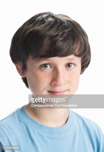 Close up portrait of smiling boy (11-12) : Stock Photo