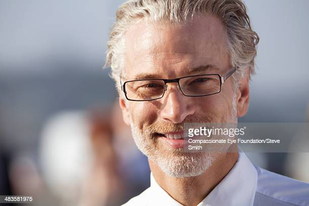 Close up portrait of smiling businessman outdoors