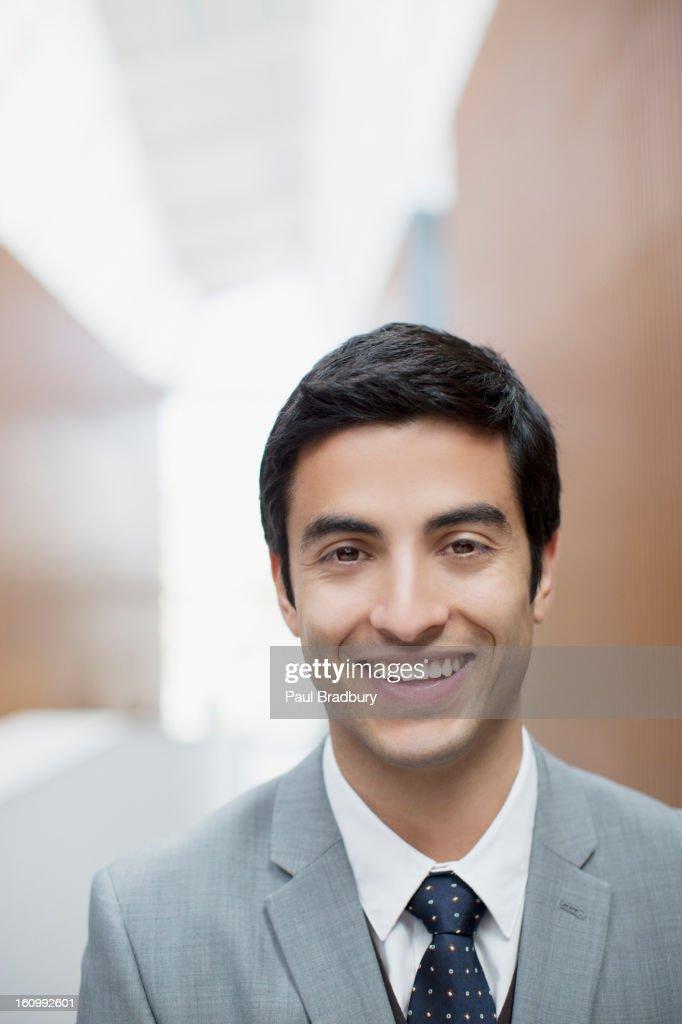 Close up portrait of smiling businessman : Stock Photo