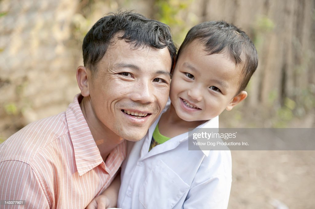 Close up Portrait of Smiling Father Hugging  Son : Stock Photo
