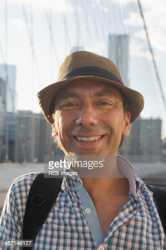 Close up portrait of smiling Hispanic man