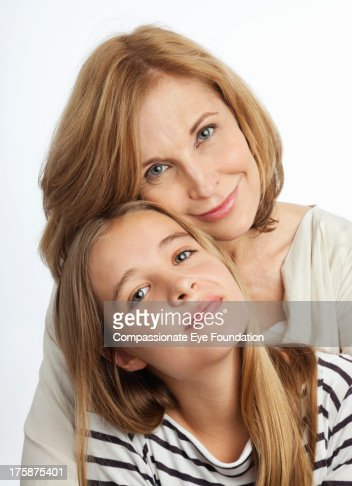 Close up portrait of smiling mother and daughter : Stock Photo