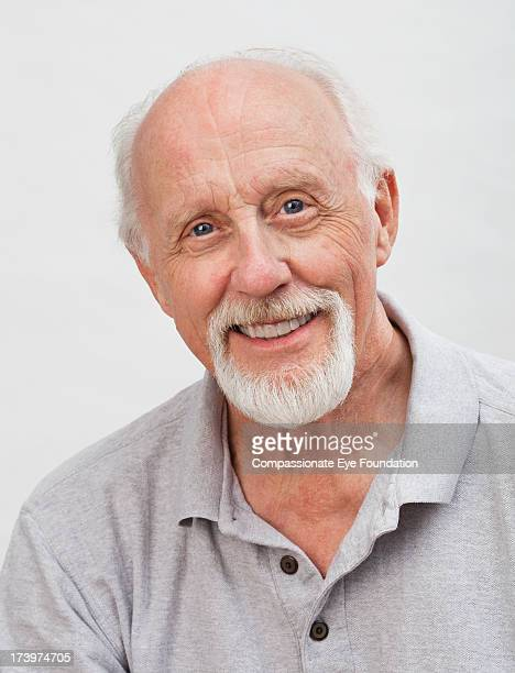 Close up portrait of smiling senior man