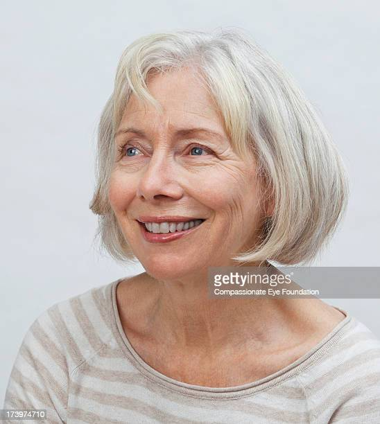 Close up portrait of smiling senior woman