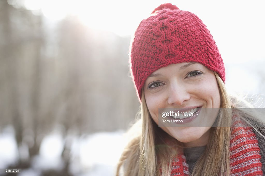 Close up portrait of smiling woman wearing red knit hat : Stock Photo