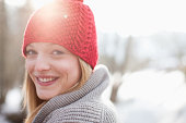 Close up portrait of smiling woman with red knit hat