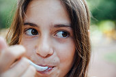 Close up portrait of teenager girl eating Ice Cream