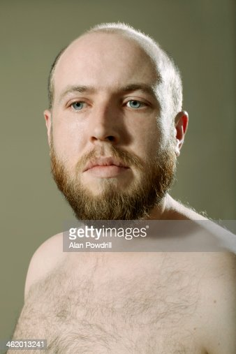 Close up portrait of topless man with beard : Stock Photo