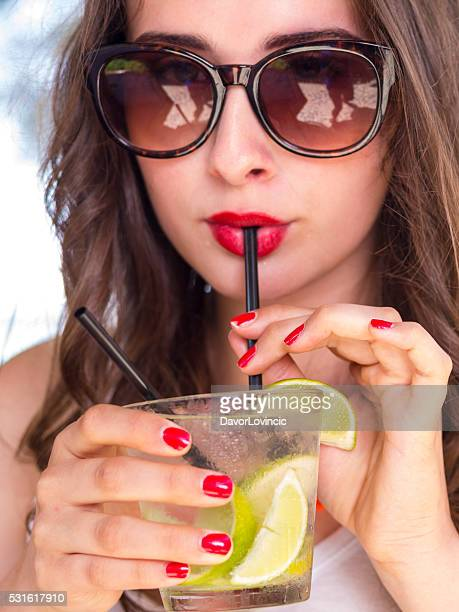 Close up portrait of woman drinking sweet Cocktail