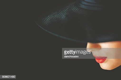 Close up portrait of woman wearing ladies' hat : Stock Photo
