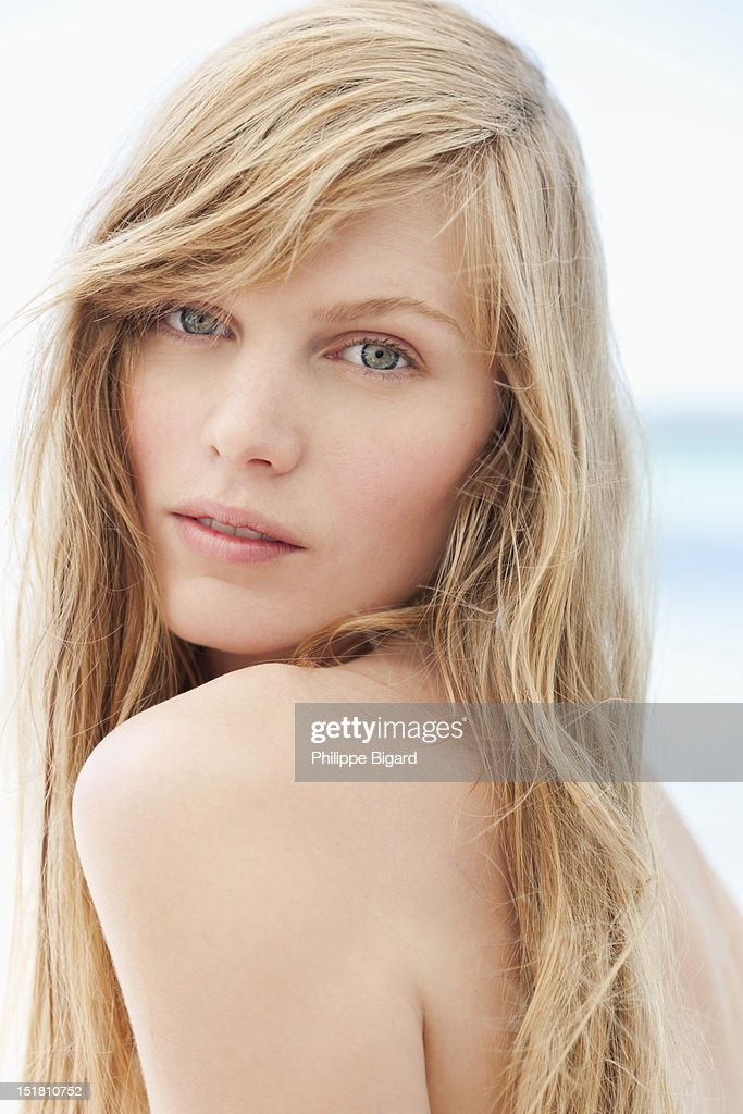 Close up portrait of woman with bare chest : Stock Photo