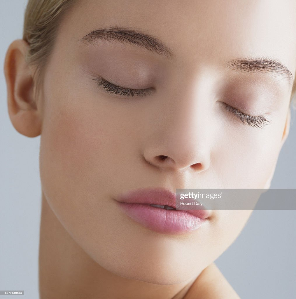 Close up portrait of woman with eyes closed : Stock Photo