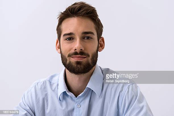 Close up portrait of young man in blue shirt