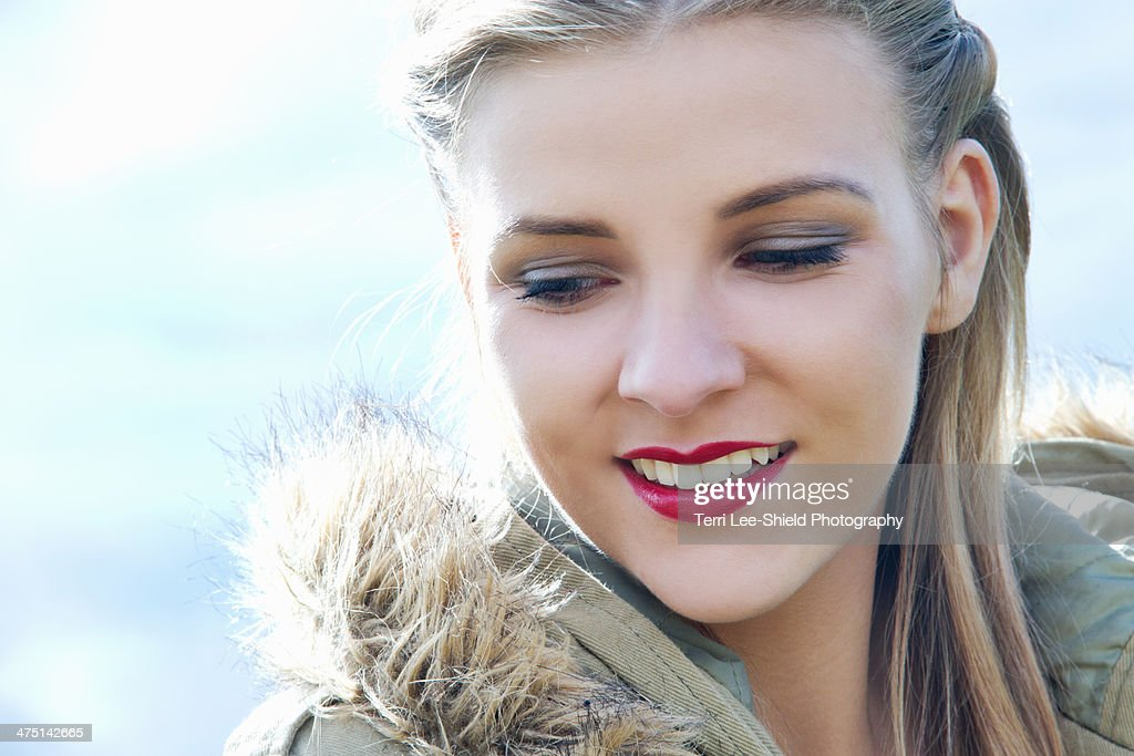 Close up portrait of young woman in parka : Stock Photo