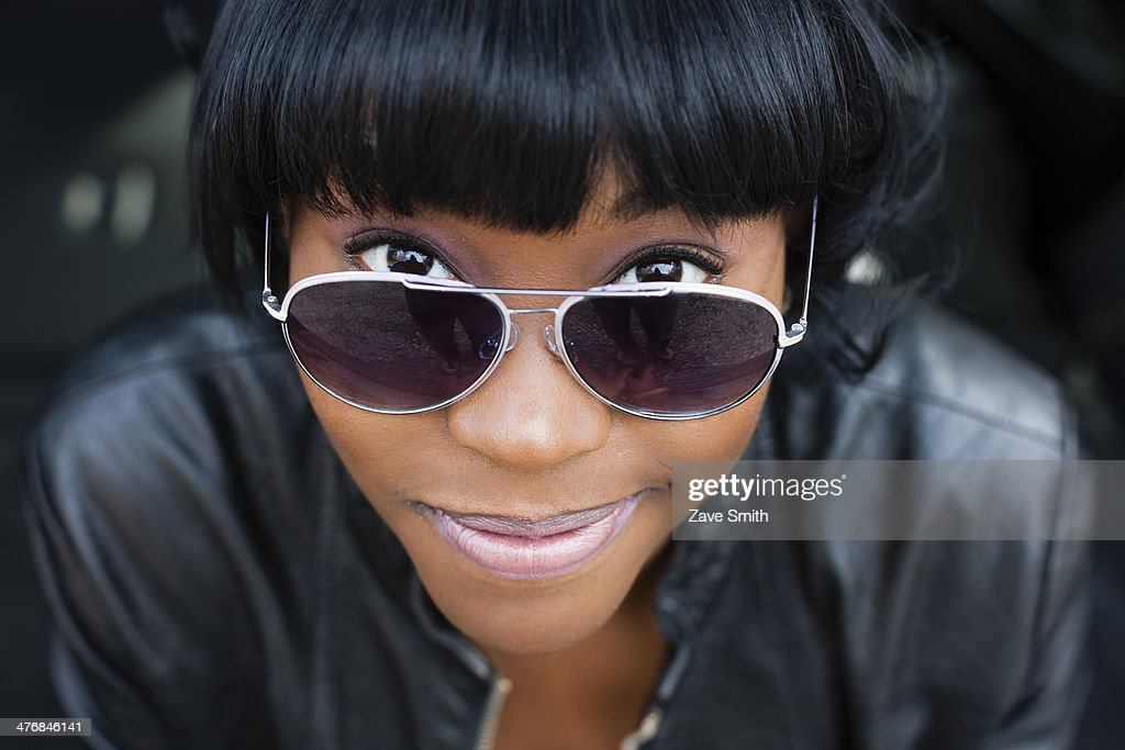 Close up portrait of young woman in sunglasses : Stock Photo