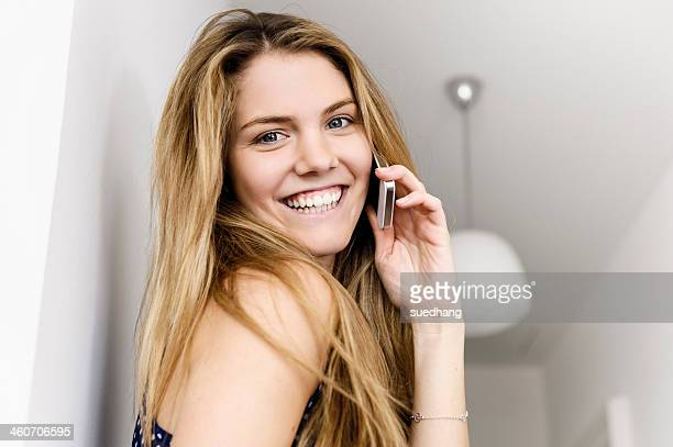 Close up portrait of young woman using mobile phone