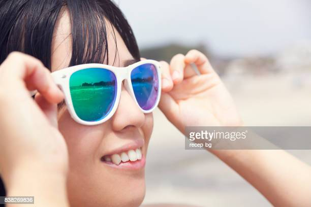 Close Up Portrait With Sunglasses And Reflections Of Sea