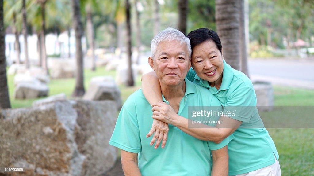 close up potrait of Asian senior couple in park background : Foto de stock