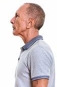 Close up profile view of senior man vertical shot