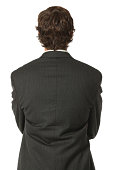 Close up rear view of isolated businessman