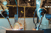 close up robot are welding automotive part in factory