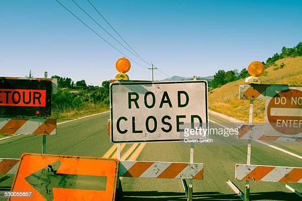 Close up row of road closed signs on highway