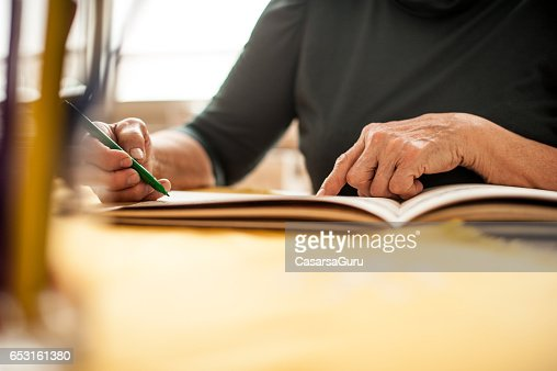 Close Up Senior Woman Hands Coloring An Adult Coloring Book : Stock Photo