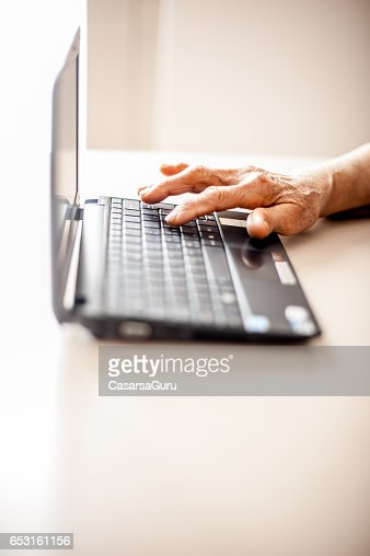Close Up Senior Woman Old Hands Using Laptop : Bildbanksbilder