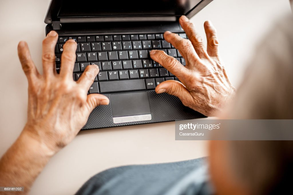 Close Up Senior Woman Old Hands Using Laptop : Stock Photo
