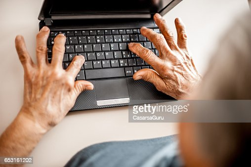 Close Up Senior Woman Old Hands Using Laptop : Photo