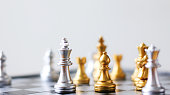 Close up shot golden and silver chess on black and white chess board game select focus shallow depth of field